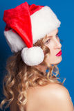 Beautiful young woman wearing Santa Claus costume Stock Image
