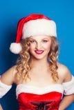 Beautiful young woman wearing Santa Claus costume Stock Photos