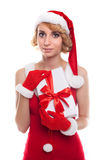 Beautiful young woman wearing Santa Claus costume holding colorf Royalty Free Stock Images