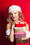 Beautiful young woman wearing Santa Claus costume Stock Images