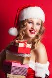Beautiful young woman wearing Santa Claus costume Stock Photo