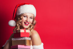 Beautiful young woman wearing Santa Claus costume Stock Image