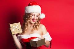 Beautiful young woman wearing Santa Claus costume Royalty Free Stock Image