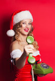 Beautiful young woman wearing Santa Claus costume Stock Photo