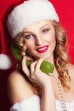 Beautiful young woman wearing Santa Claus costume Stock Photography
