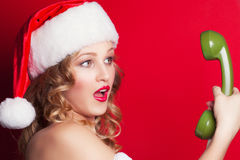 Beautiful young woman wearing Santa Claus costume Royalty Free Stock Photo