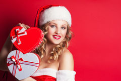 Beautiful young woman wearing Santa Claus costume Stock Photography