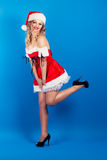 Beautiful young woman wearing Santa Claus costume Stock Photos