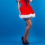 beautiful young woman wearing Santa Claus costume posing against Stock Photography