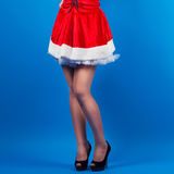 beautiful young woman wearing Santa Claus costume posing against Royalty Free Stock Photo