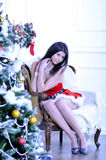 Beautiful young woman wearing in santa clause costume Stock Photography