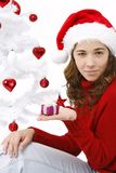 Beautiful young woman wearing santa hat Stock Photos