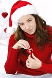 Beautiful young woman wearing santa hat Stock Images