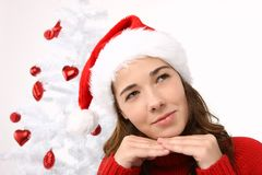 Beautiful young woman wearing santa hat Stock Photo