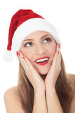 Beautiful young woman wearing santa hat Royalty Free Stock Images