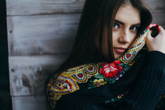 Beautiful young woman wearing scarf. Dark-haired, lovely girl Royalty Free Stock Image