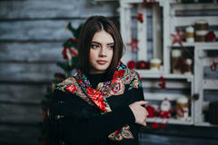 Beautiful young woman wearing scarf. Dark-haired, lovely girl Royalty Free Stock Photos