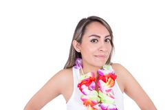 Beautiful young woman wearing shorts and a flower Stock Photo