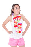 Beautiful young woman wearing shorts and a flower. Beautiful young latin woman wearing shorts and a flower lei  on white Royalty Free Stock Photo