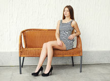Beautiful young woman wearing a striped dress Stock Image