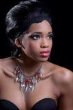 Beautiful young woman wearing stylish necklace. Beautiful young black woman wearing stylish necklace royalty free stock photo