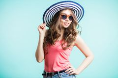 Beautiful young woman wearing summer hat with large brim. and with a smile looking at the camera royalty free stock photos