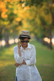 Beautiful young woman wearing sun glassea nd straw hat talking o Stock Photo
