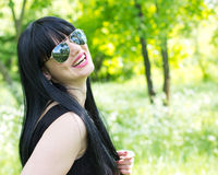 Beautiful young woman wearing sunglasses Royalty Free Stock Photography