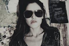 Beautiful young woman wearing sunglasses Stock Photos