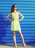 Beautiful young woman wearing a sunglasses and yellow dress Royalty Free Stock Images