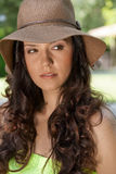 Beautiful young woman wearing sunhat looking away in park Stock Photography
