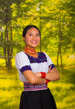 Beautiful young woman wearing traditional andean blouse with necklace, standing posing for camera, arms crossed smiling Stock Photos
