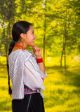 Beautiful young woman wearing traditional andean blouse with necklace, standing posing for camera, thoughtful body Stock Photo