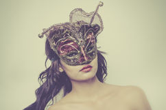 Beautiful young woman wearing Venetian mask Stock Photos