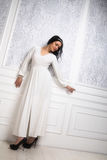 Beautiful young woman wearing white dress  and hairstyle in retr Royalty Free Stock Photography
