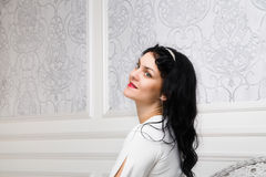 Beautiful young woman wearing white dress  and hairstyle in retr Stock Images