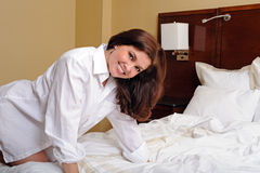 Beautiful young woman wearing only a white shirt Stock Photography