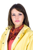 Beautiful young woman wearing a yellow rain-coat Stock Photo