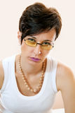 Beautiful young woman wears trendy glasses. Studio shoot. It is not isolated Stock Photo