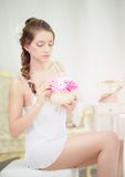 Young Woman with bouqet of chrysanthemum Royalty Free Stock Photo