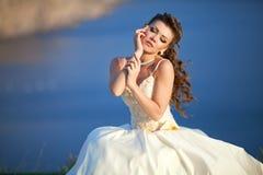 Beautiful young woman in wedding dress. Portrait of a beautiful young woman in a wedding dress stock photos