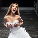 Beautiful young woman in wedding dress Stock Photo