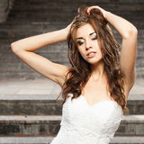 Beautiful young woman in wedding dress Stock Image