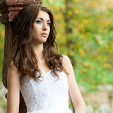 Beautiful young woman in wedding dress Stock Photos