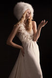 The beautiful young woman in a wedding dress Stock Images