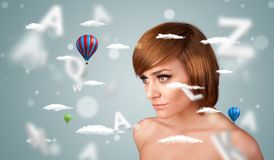 Beautiful young woman with wellness and healthcare clouds Royalty Free Stock Photo