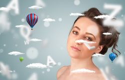 Beautiful young woman with wellness and healthcare clouds Royalty Free Stock Images