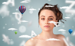 Beautiful young woman with wellness and healthcare clouds Stock Photos
