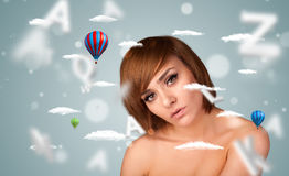 Beautiful young woman with wellness and healthcare clouds Royalty Free Stock Image