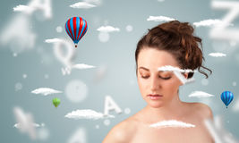 Beautiful young woman with wellness and healthcare clouds. On gradient background royalty free stock photo
